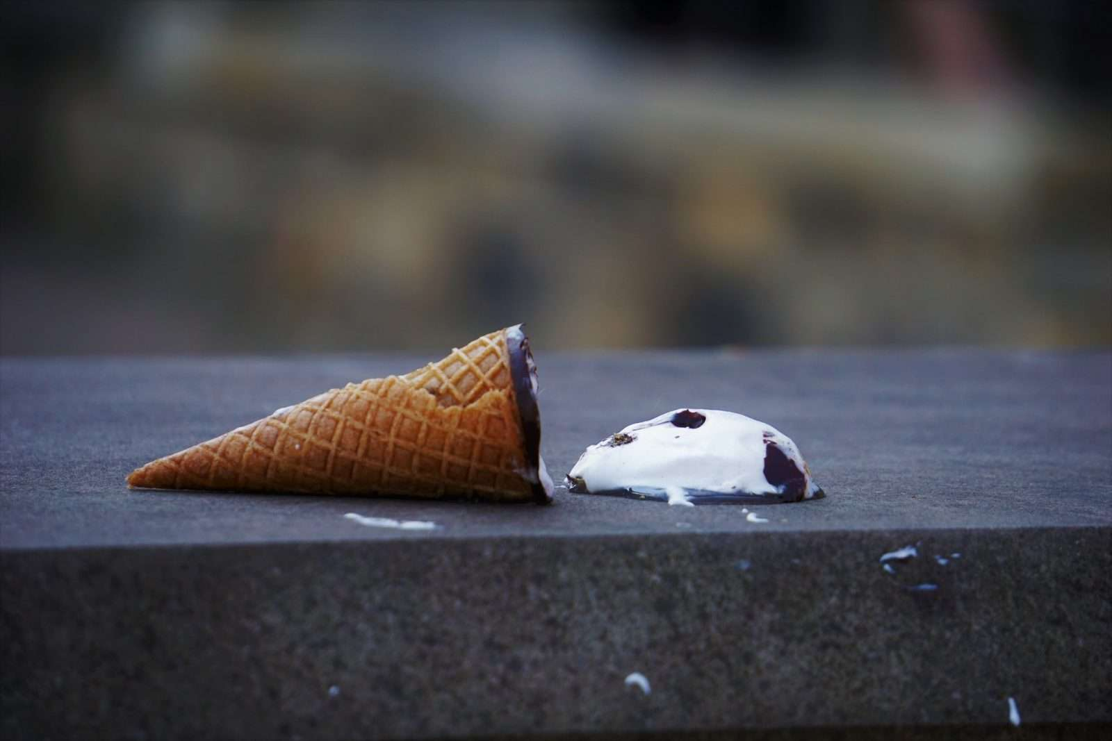 Losing an ice cream cone by dropping it.